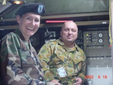 104 Sig Sqn Soldier showing one of the other ABCA Girls his Rig